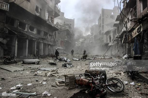 Search and rescue members inspect the area after Assad Regime's forces carried out air strikes over the deconflict zone at the Jisr alShughur...