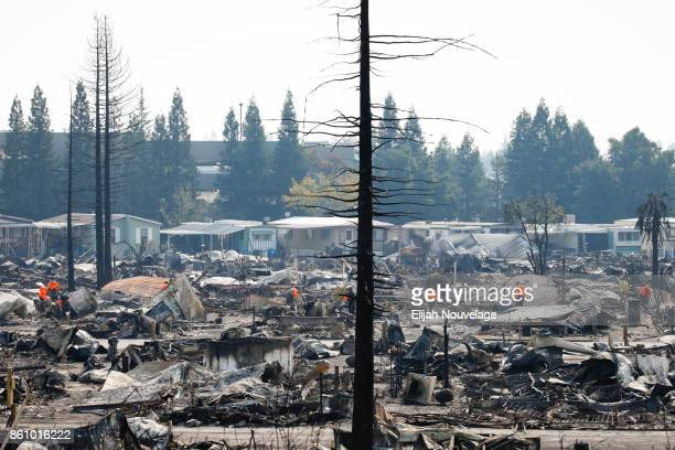 Search and Rescue personnel look for human remains in the Journey's End Mobile Home park following the damage caused by the Tubbs Fire on October 13...