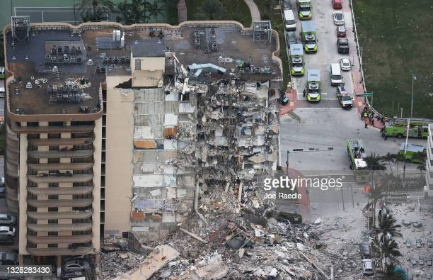 Search and Rescue personnel work after the partial collapse of the 12-story Champlain Towers South condo building on June 24, 2021 in Surfside,...