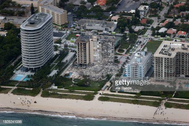 Search and rescue personnel work in the rubble of the 12-story condo tower that partially collapsed on June 24, 2021 in Surfside, Florida. It is...