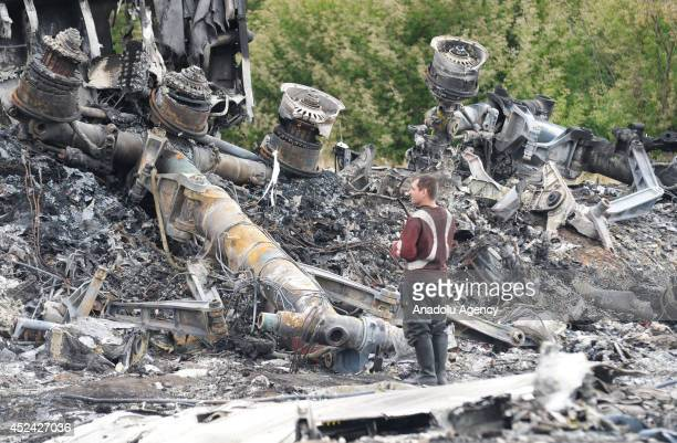 Search and rescue specialists inspect at the crash area of Malaysia Airlines Boeing 777, carrying 295 people from Amsterdam to Kuala Lumpur and...