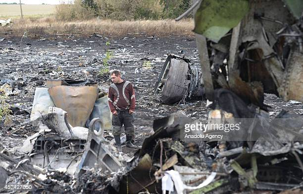 Search and rescue specialists inspect at the crash area of Malaysia Airlines Boeing 777 carrying 295 people from Amsterdam to Kuala Lumpur and downed...