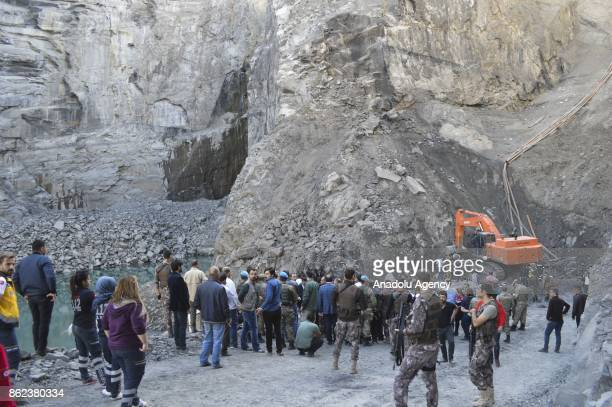 Search and rescue team along with security forces conduct a rescue operation on the debris after an illegal coal mine collapsed in Sirnak Turkey on...