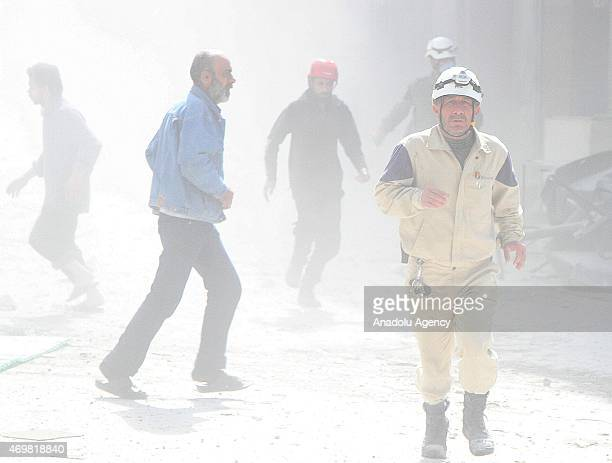 Search and rescue team arrive scene of attack after a barrel bomb attack staged by Syrian regime forces to the residential areas in the Sukkari area...