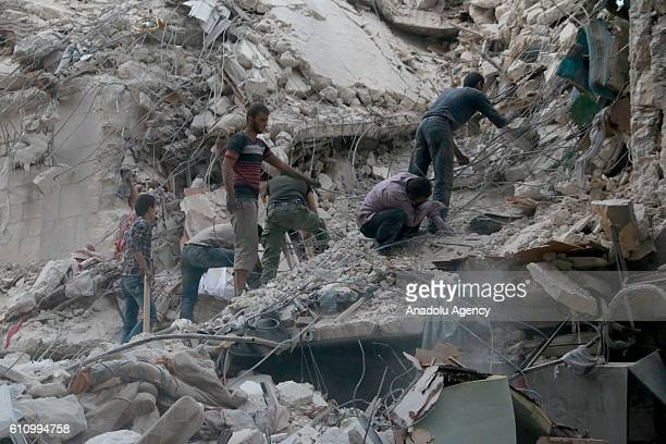Search and rescue team members carry out search and rescue operation on the rubble of a building after the war crafts belonging to the Russian Army...