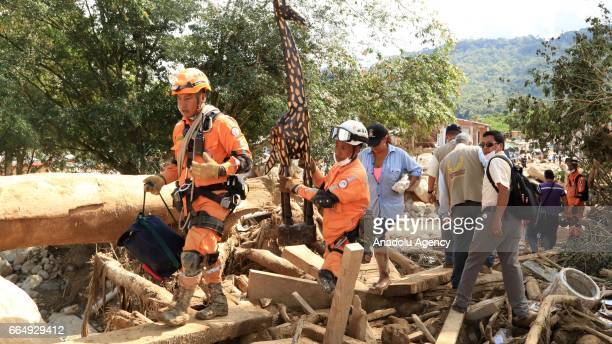 Search and rescue team members conduct an operation to rescue victims of the landslide that triggered by a flood following heavy rains in Mocoa...