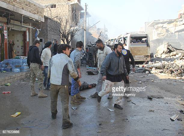 Search and rescue team members work at site after Assad Regime forces carried out an airstrike over a market in Kafr Nabl district of Idlib Syria on...