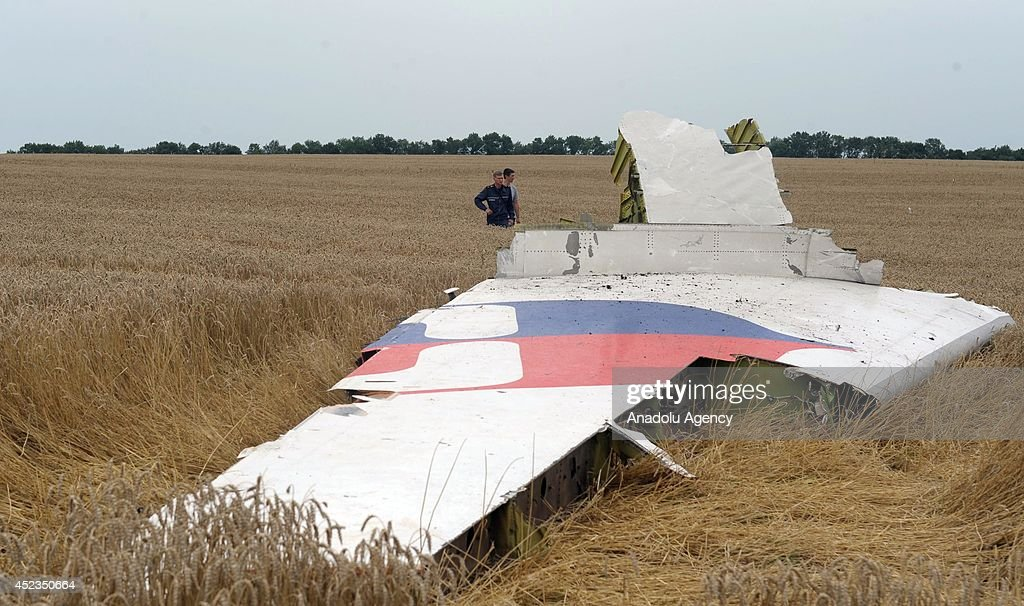 Search and rescue team search for human remains amongst the wreckages of a Malaysia Airlines Boeing 777 carrying 295 people from Amsterdam to Kuala Lumpur after it was downed close to Russia's border with Ukraine on July 17, 2014, near the town of Donetsk, Ukraine on July 18, 2014.