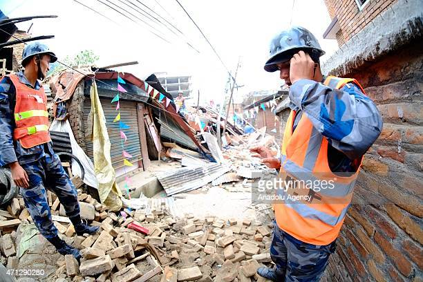 Search and rescue team work among the debris of houses after a powerful earthquake hits Katmandu Nepal on April 26 2015 The death toll in Nepal...