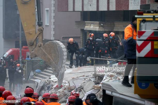 Search and rescue teams attend a rescue work at the site on February 7 2019 after a sevenstory building on Istanbuls Asian side collapsed 12 people...