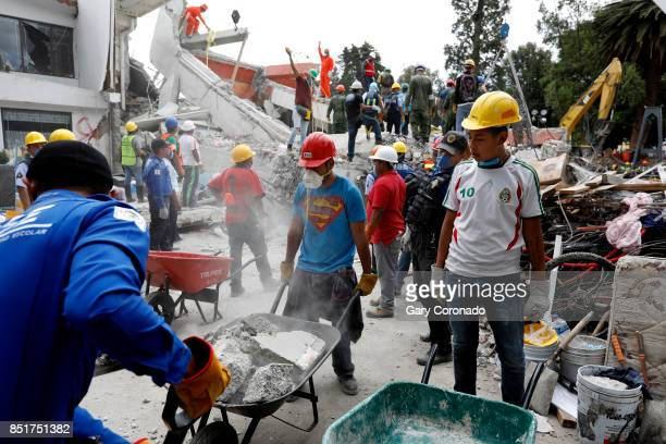 Search and rescue teams continue to search for victims trapped under the rubble at the Neto supermarket in the San Gregorio Atlapulco neighborhood of...
