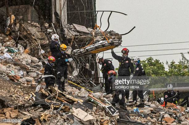 Search and Rescue teams look for possible survivors in the partially collapsed 12-story Champlain Towers South condo building on June 28, 2021 in...