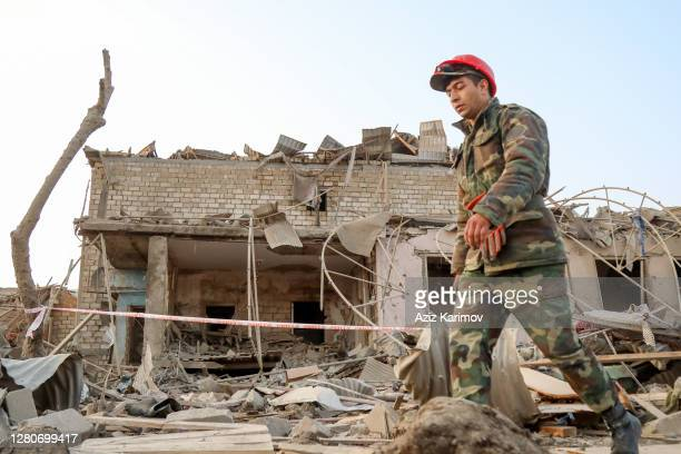 Search and rescue teams work on the blast site hit by a rocket during the fighting over the breakaway region of Nagorno-Karabakh on October 17, 2020...