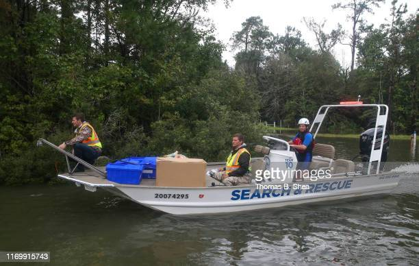 Search and Rescue volunteers from Arkansas navigates the flooded waters on highway 124 on September 20 2019 in Beaumont Texas Gov Greg Abbott has...