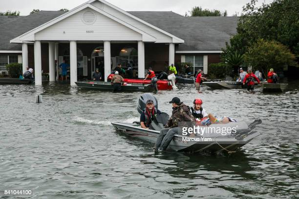 Search and rescue volunteers rescue patients from the Cypress Glen nursing home engulf in floodwater in Port Arthur Texas on Aug 30 2017