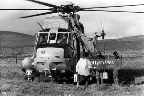 Search and rescue Westland Sea King helicopter taking police officers to an accident crash site. Two RAF Jaguar aircraft, from RAF Coltishall, had...