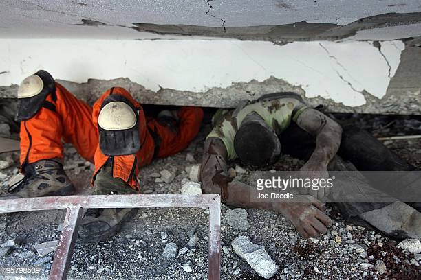 Search and Rescue worker from Mexico makes his way past two bodies as he searches for survivors trapped under the rubble of what is left of the...