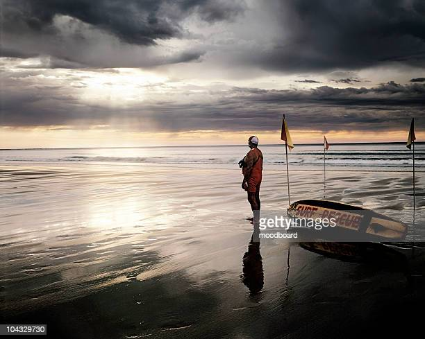 search and rescue worker standing on the beach - coast guard stock pictures, royalty-free photos & images