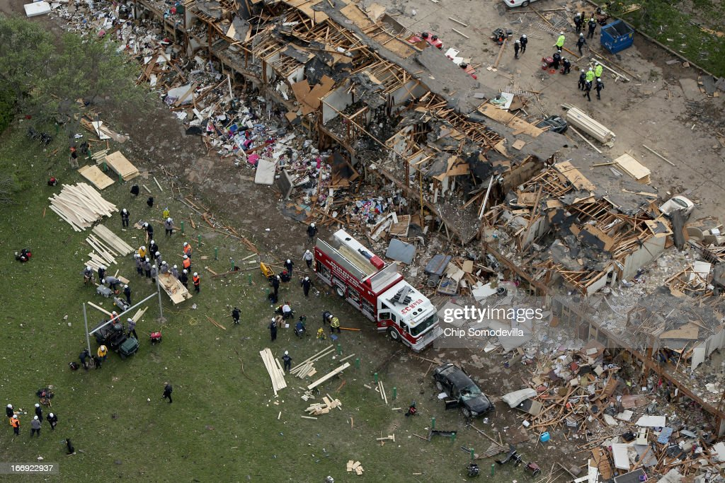 Search and rescue workers comb through what remains of a 50-unit apartment building the day after an explosion at the West Fertilizer Company destroyed the building April 18, 2013 in West, Texas. According to West Mayor Tommy Muska, around 14 people, including 10 first responders, were killed and more than 150 people were injured when the fertilizer company caught fire and exploded, leaving damaged buildings for blocks in every direction.