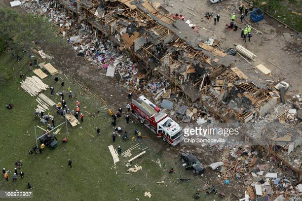 Search and rescue workers comb through what remains of a 50unit apartment building the day after an explosion at the West Fertilizer Company...