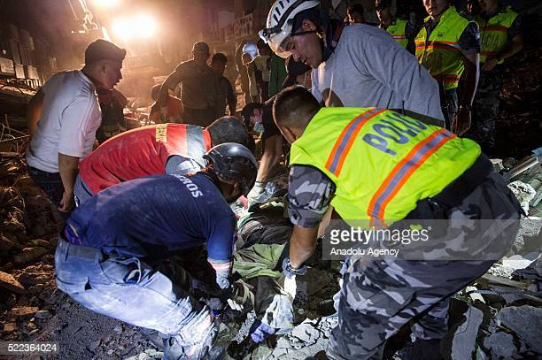 Search and rescue workers on duty over the collapsed buildings in Pedernales Manabi Province of Ecuador on April 18 2016 At least 238 people have...