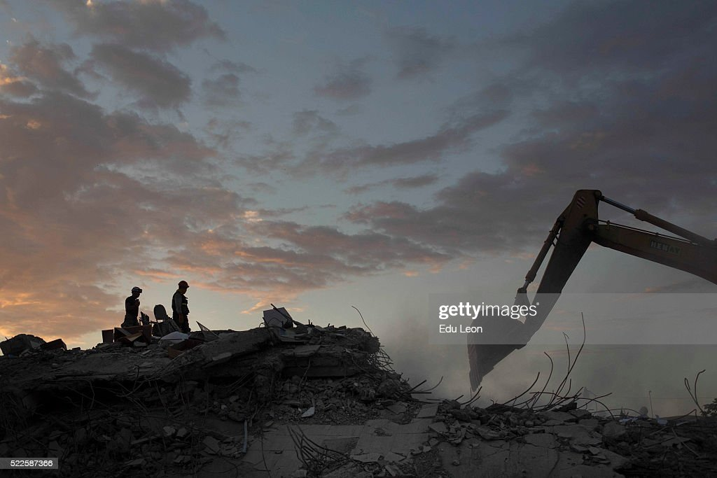 Search and rescue workers on duty over the collapsed buildings in Pedernales after the earthquake in Ecuador on April 19, 2016 in Pedernales, Ecuador. At least 400 people were killed after a 7.8-magnitude quake.