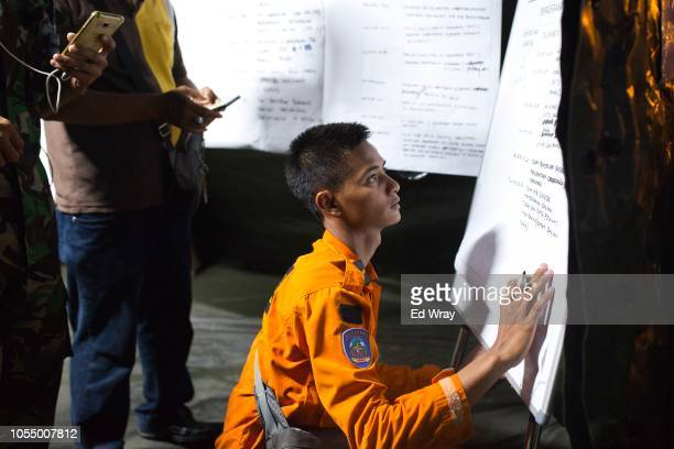 Search and rescue workers updates a chart at a mobile command center set up to receive the remains of Lion Air flight JT 610 and its passengers at...