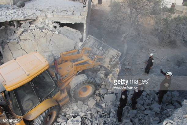 Search and rescue works are carried out at the scene after airstrikes hit Khan Sheikhun town of Idlib Syria on September 21 2017