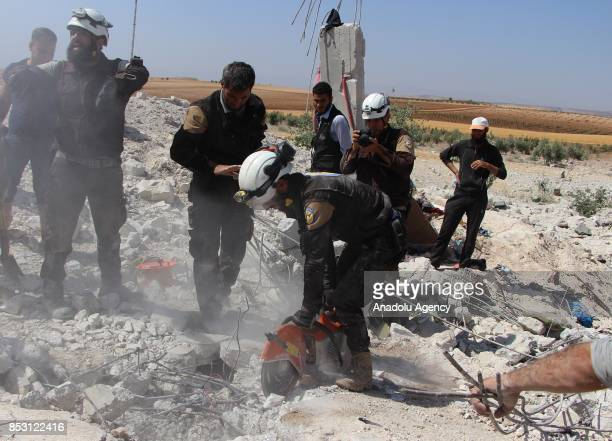 Search and rescue works are carried out at the scene after airstrikes hit Khan Sheikhun town of Idlib Syria on September 24 2017 At least 4 civilians...