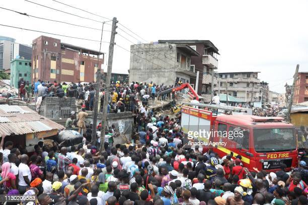 Search and rescue works are carried out at the site after a schoolhouse on Lagos Island collapsed on March 13 2019 in Lagos Nigeria A rescue worker...