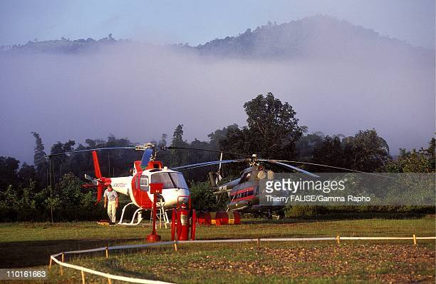Search for missing American soldiers in Laos in 2000 Choppers ready to take off on the heliport near the base camp