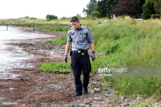 A search team from the Danish Emergency Services looks for body parts following the death of journalist Kim Wall at the waters on southern Amager on...
