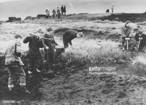 Searchers digging in peat on Saddleworth Moor near Greenfield Yorkshire in the search for victims of the Moors murderers Ian Brady and Myra Hindley...