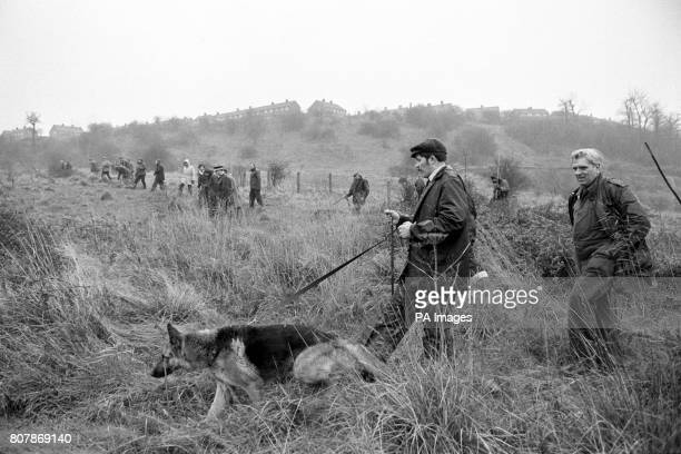 Searchers with tracker dogs search the countryside at Sedgley near Dudley in Worcestershire for the kidnapped heiress Lesley Whittle