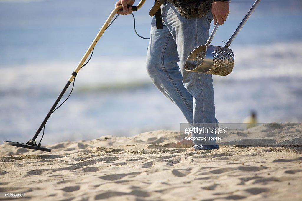 Searches a beach : Stock Photo