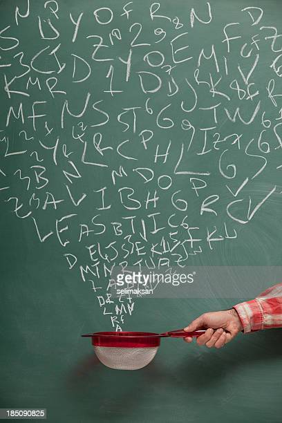 searching and filtering words on blackboard via strainer - single word stock pictures, royalty-free photos & images