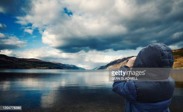 searching for loch ness monster - loch ness monster stock pictures, royalty-free photos & images