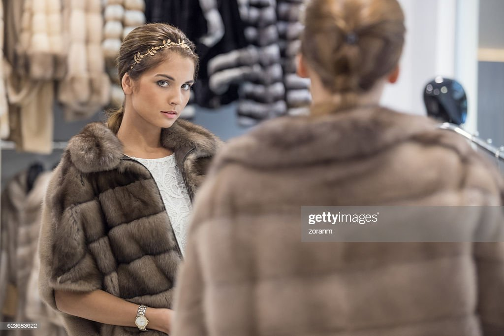 Searching for perfect fur coat : Stock Photo