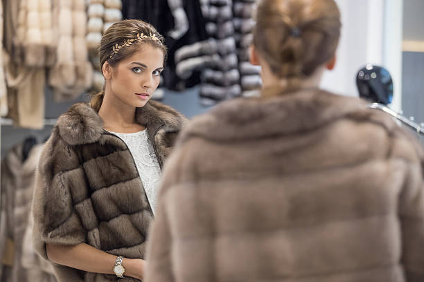 searching for perfect fur coat - woman in fur coat stock pictures, royalty-free photos & images