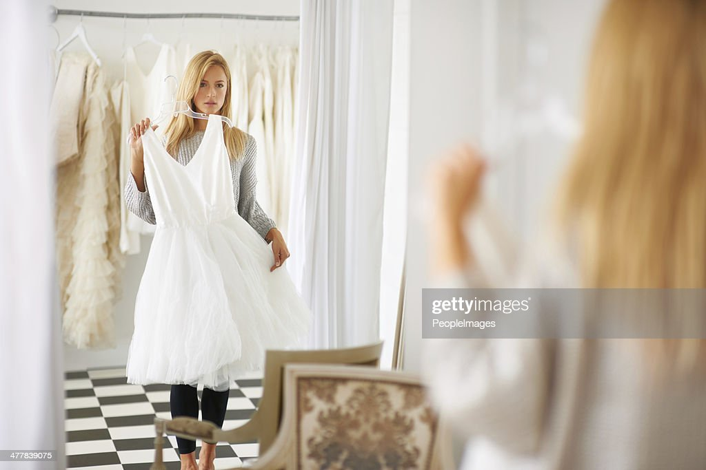 Searching for that special dress : Stock Photo