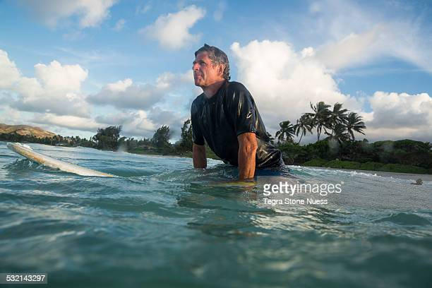 searching for the next wave - one man only stock pictures, royalty-free photos & images