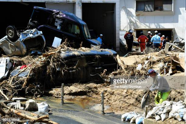 Searching operation continues on July 13 2018 in Hiroshima Japan The death toll from the torrential rain in western Japan due to landslides flooding...