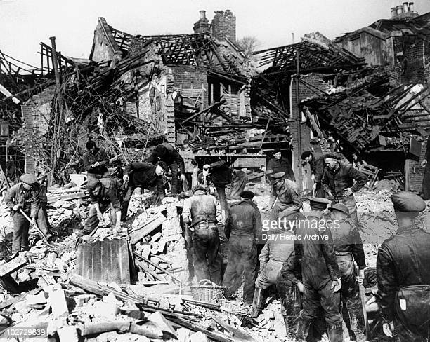 Searching the wreckage of houses for victims Second World War c 1942 Rescue workers searching the wreckage of houses for victims during the Blitz...