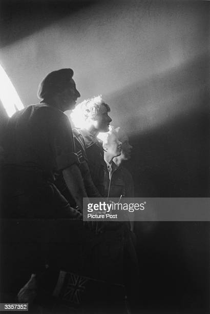 Searchlights are no longer used to spot enemy aircraft, but to drench London in the glow of victory, on VE Day, 8th May 1945. Picture Post - 1991 -...