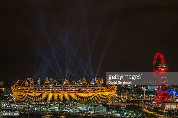 Searchlights over the Olympic Stadium during the opening ceremony of the 2012 London Olympic Games on July 27 2012 in London England Athletes heads...