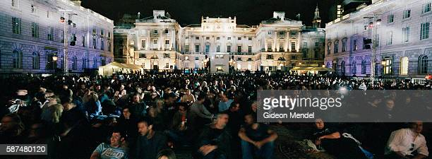 Searchlights sweep across a capacity audience of 2000 moviegoers within the majestic backdrop of the 18th century Somerset House Courtyard They were...