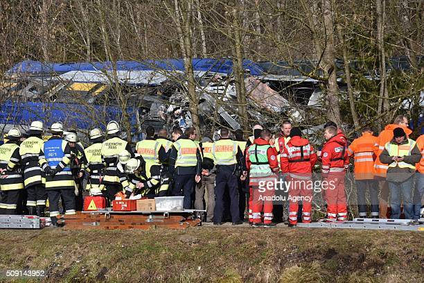 Searchrescue team workers and firefighters are seen on duty on a two trains' collision site after two commuter trains collied on a route close to Bad...