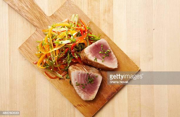 seared ahi tuna and garnish - yellowfin tuna stock photos and pictures