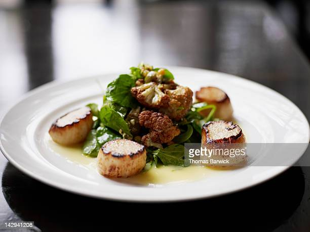 seared alaskan scallops with roasted cauliflower - gourmet stock pictures, royalty-free photos & images