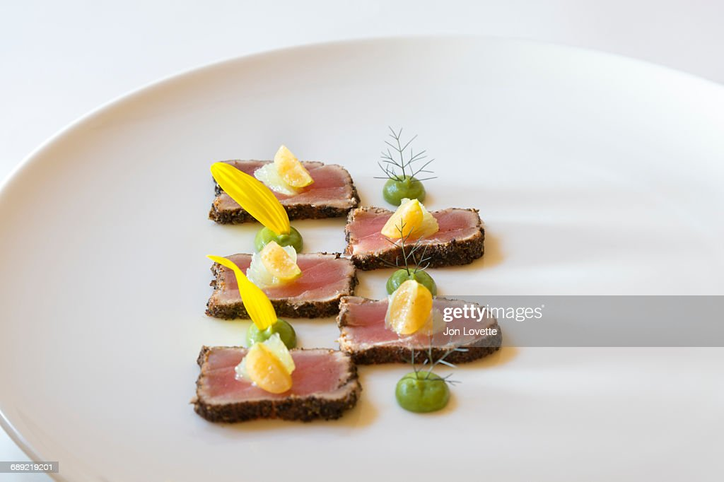 Seared Asian style Tuna on white plate : Stock Photo